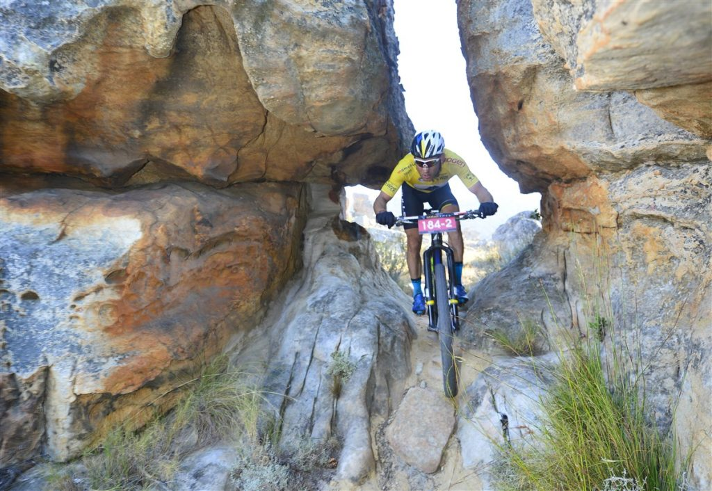 Switzerland's Urs Huber negotiates a tricky rock section on his way to winning the final stage and the overall title with teammate, Karl Platt, at the Momemtum Health Tankwa Trek, presented by Biogen on Sunday. Photo credit: www.zcmc.co.za