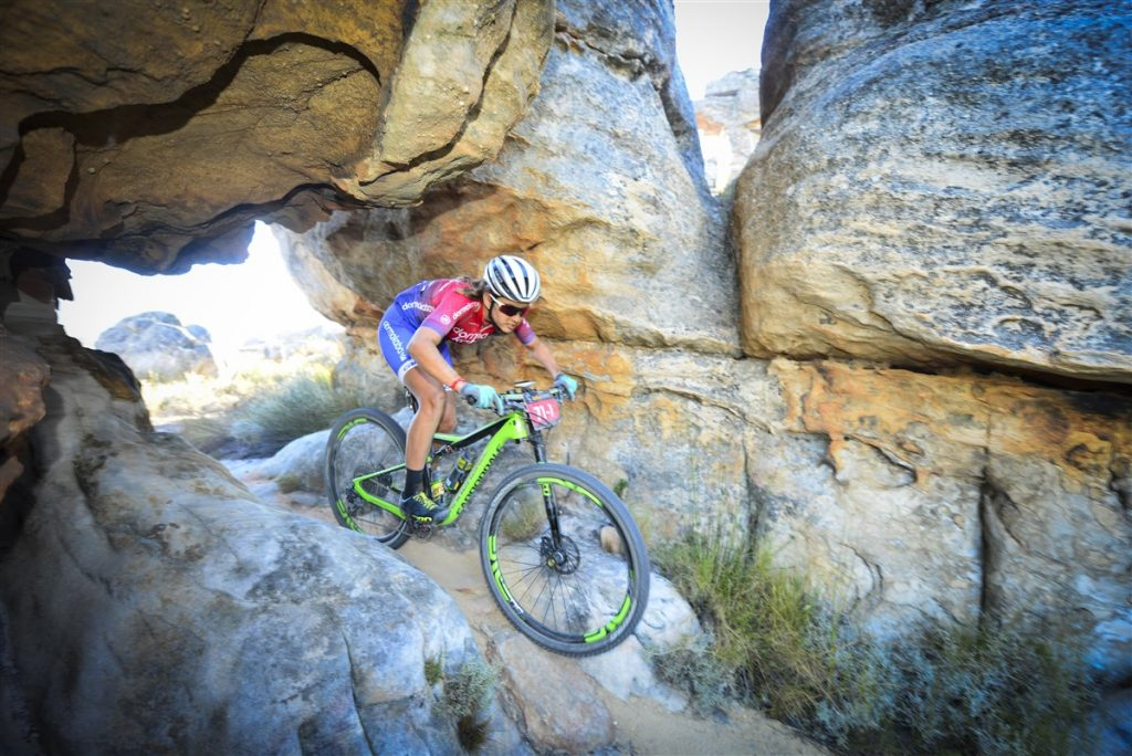Candice Lill makes her way through a rock formation section during the final stage of the Momemtum Health Tankwa Trek, presented by Biogen on Sunday. Photo credit: www.zcmc.co.za
