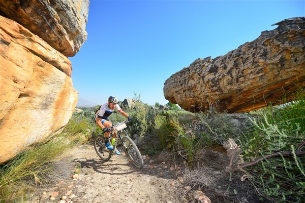 Ancient rock formations of the Kouebokkeveld region create an interesting landscape for competitors at the Momentum Health Tankwa Trek, presented by Biogen, South Africa's most prestigious three-day mountain bike stage race, which takes place from 10-12 February. Here, 2016 winner, Urs Huber, negotiates his way through Stage 1 singletrack. Photo credit: www.zcmc.co.za
