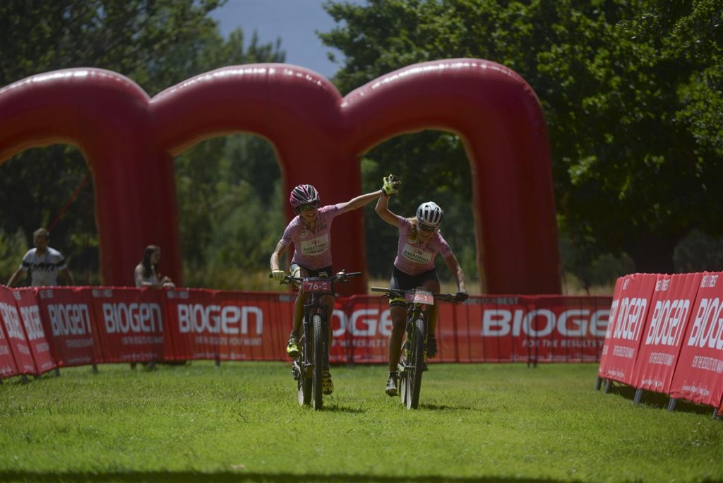 Esther Süss (left) and Jennie Stenerhag celebrate winning the overall title of the Momemtum Health Tankwa Trek, presented by Biogen on Sunday. Photo credit: www.zcmc.co.za