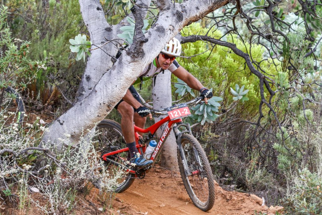 Brendan Dower ducks under the limbs of a Waboom (Protea Nitida) during the DUTOIT drop section of Stage 2 of the Momentum Health Tankwa Trek, presented by Biogen, on Saturday the 11th of February 2017. Protea nitida