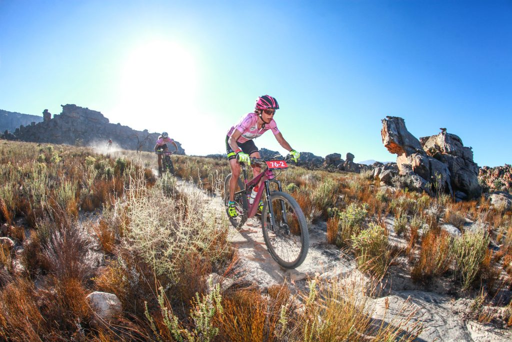Women's champions Esther Suss (front) and Jennie Stenerhag (behind) race through the Houdenbek singletracks during Stage 3 of the Momentum Health Tankwa Trek, presented by Biogen, on Sunday the 12th of February 2017.