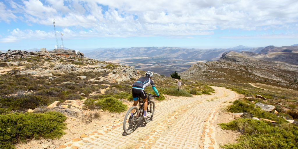 GV. A rider begins the descent from 1850 meters above sea level and the top of the Merino Monster to the Koue Bokkeveld over 800 meters below; during Stage 2 of the Momentum Health Tankwa Trek, presented by Biogen, on Saturday the 11th of February 2017.