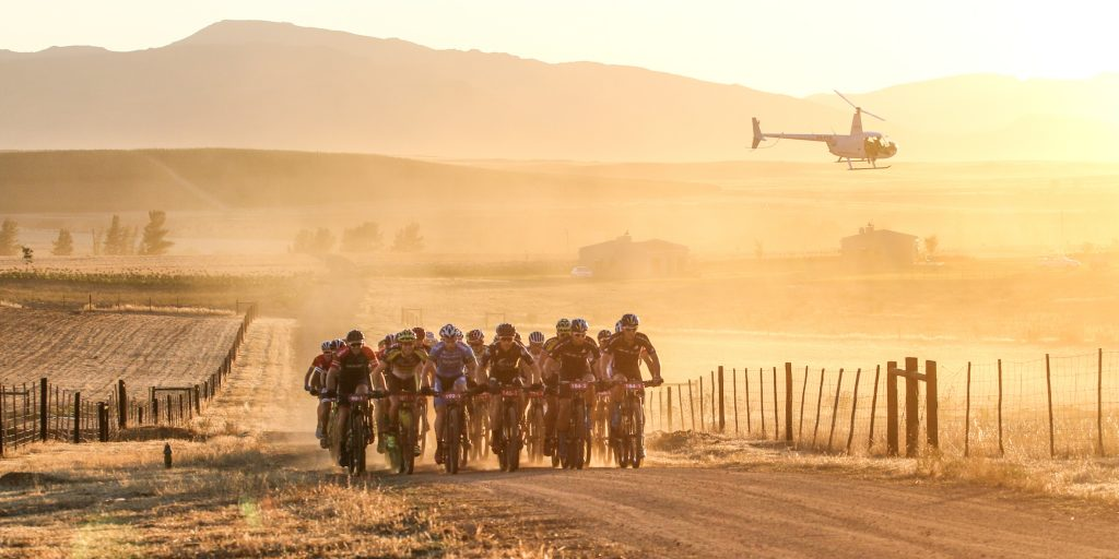 GV. Riders cross the dusty farm roads of the Koue Bokkeveld during Stauge 1 of the Momentum Health Tankwa Trek, presented by Biogen, on 10 February 2017.