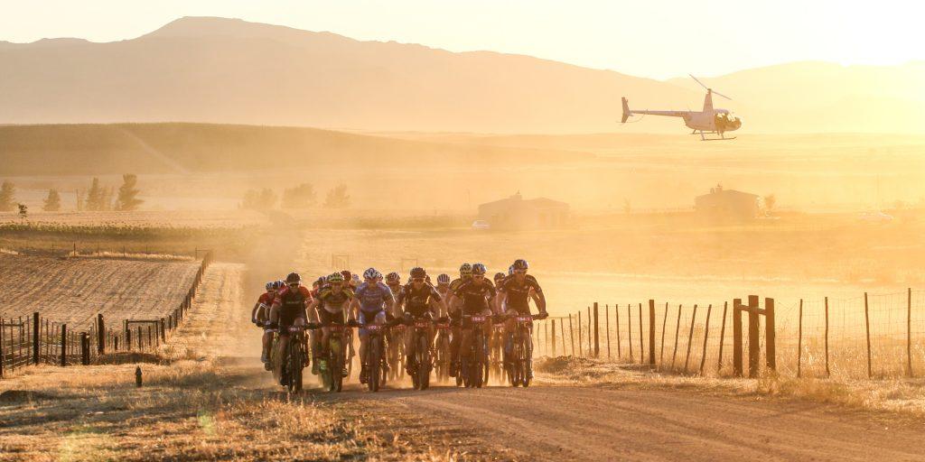 GV. Riders cross the dusty farm roads of the Koue Bokkeveld during Stauge 1 of the Momentum Health Tankwa Trek, presented by Biogen, on 10 February 2017.