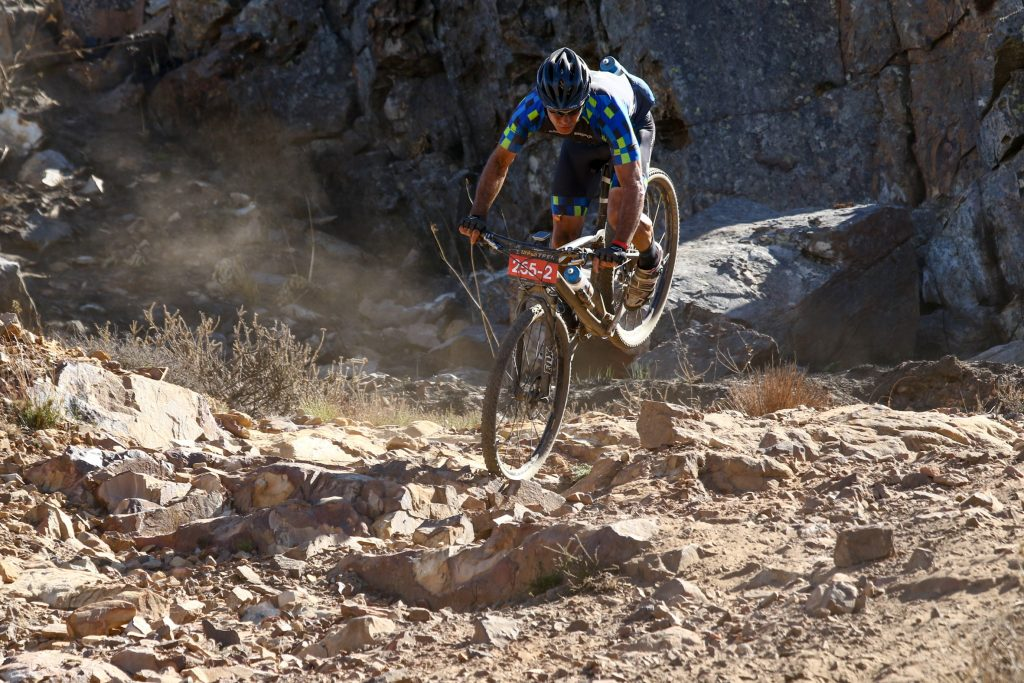Eugene Botha gets near vertical after getting a technical descent a little bit wrong during Stage 1 of the Momentum Health Tankwa Trek, pressented by Biogen, on 10 February 2017.