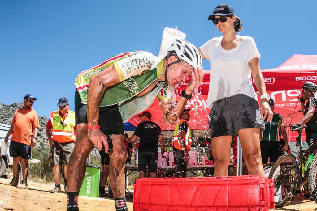 A rider attempts to cool off in the searing heat of the Witzenberg Valley, were temperatures nearly reached  40 degrees Celsius during Stage 1 of the Momentum Health Tankwa Trek, presented by Biogen, on 10 February 2017.
