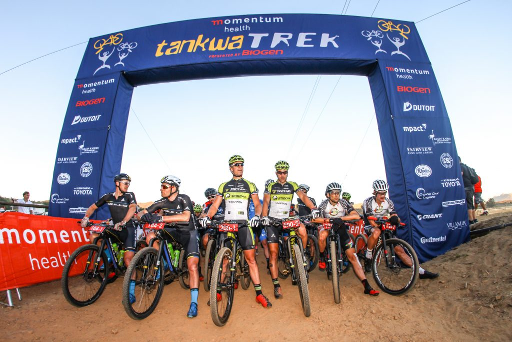 The UCI Elite Men's field, including from left to right Karl Platt, Urs Huber, Kristian Hynek, Alban Lakata, Christoph Sauser and Sam Gaze, line up for the start of the Momentum Health Tankwa Trek, presented by Biogen. On 10 February 2017.