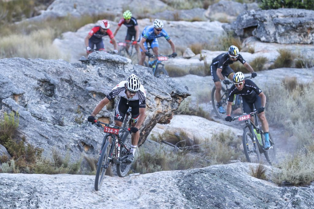 Investec-songo-Specialized rider, and Under 23 Cross-Country World Champion, Sam Gaze leads the UCI Elite Men's field through the boulder strewn trails of the Witzenberg Valley, during Stage 1 of the Momentum Health Tankwa Trek, presented by Biogen, on 10 February 2017.